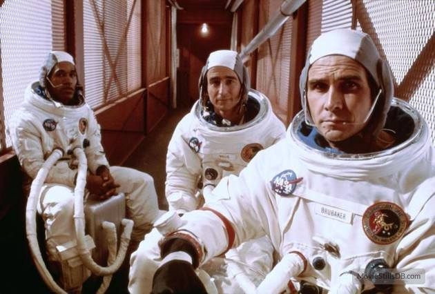 O.J. Simpson, Sam Waterston, and James Brolin in space suits