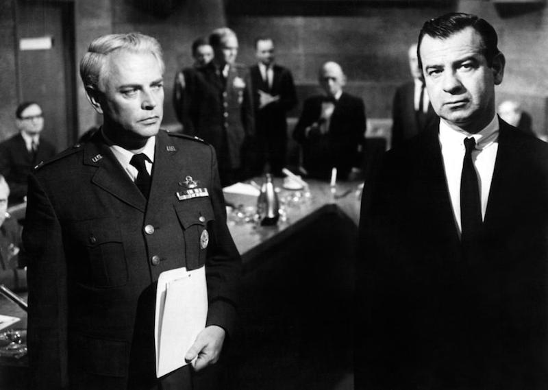 At the Pentagon war conference room, USAF Brigadier General Black (Dan O'Herlihy) seems to distrust supremely confident DoD advisor Prof. Groeteschele (Walter Matthau).