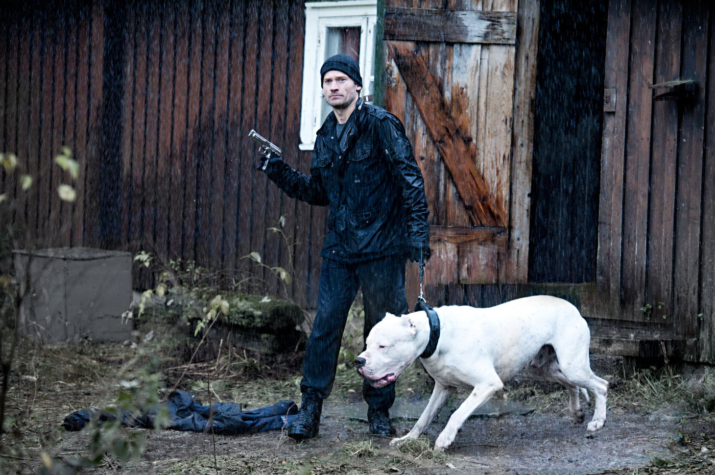 Clas (Nikolaj Coster-Waldau) and his friendly pooch are out for a walk.
