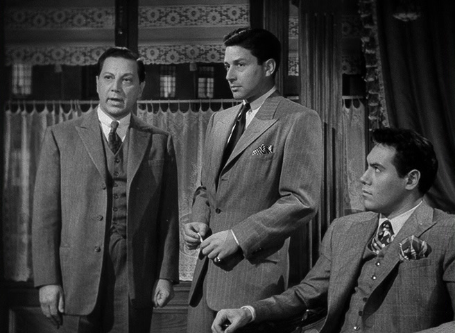 The scheming brothers Monetti: Joe (Luther Adler), Tony (Efrem Zimbalist Jr.), and Pietro (Paul Valentine)