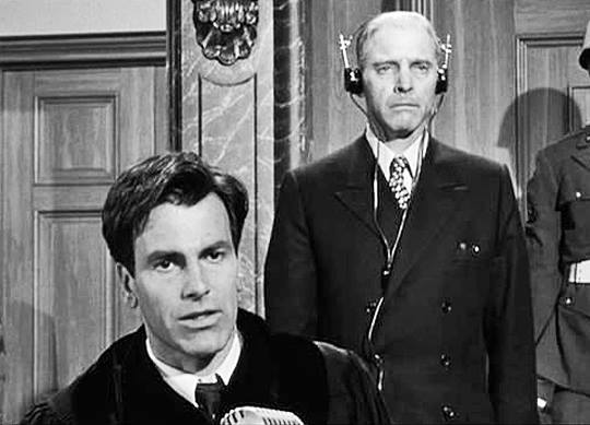 German attorney Hans Rolfe (Maximilian Schell) defends Nazi judge Dr. Ernst Janning (Burt Lancaster) before the Nuremberg Military Tribunal.