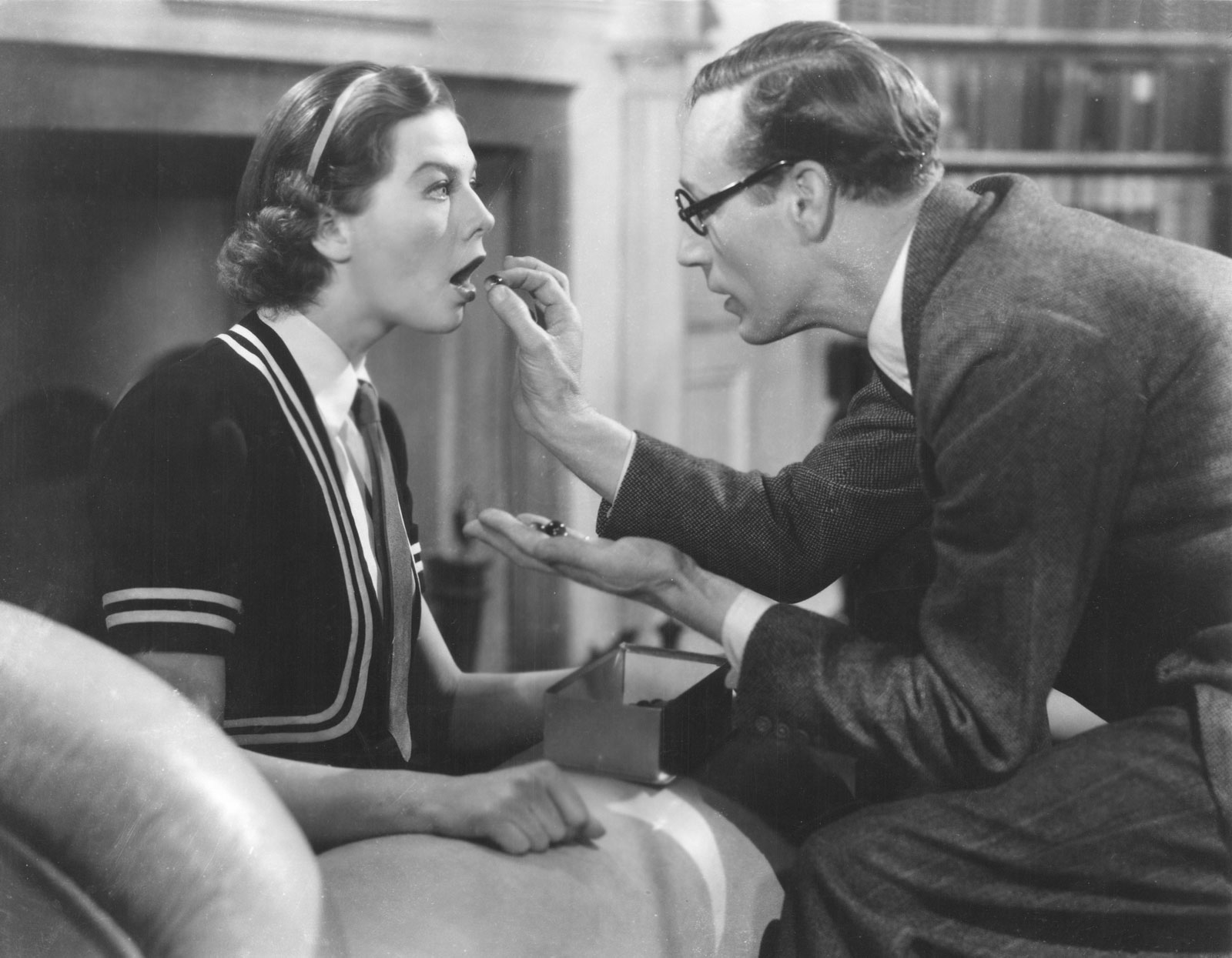 Wendy Hiller receives speech therapy with marbles from Leslie Howard.