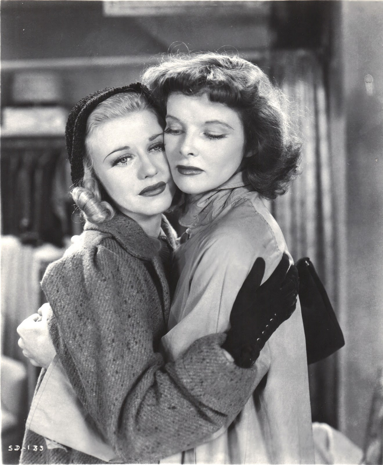 Jean Maitland (Ginger Rogers) receives a consoling hug from Terry Randall (Katharine Hepburn).