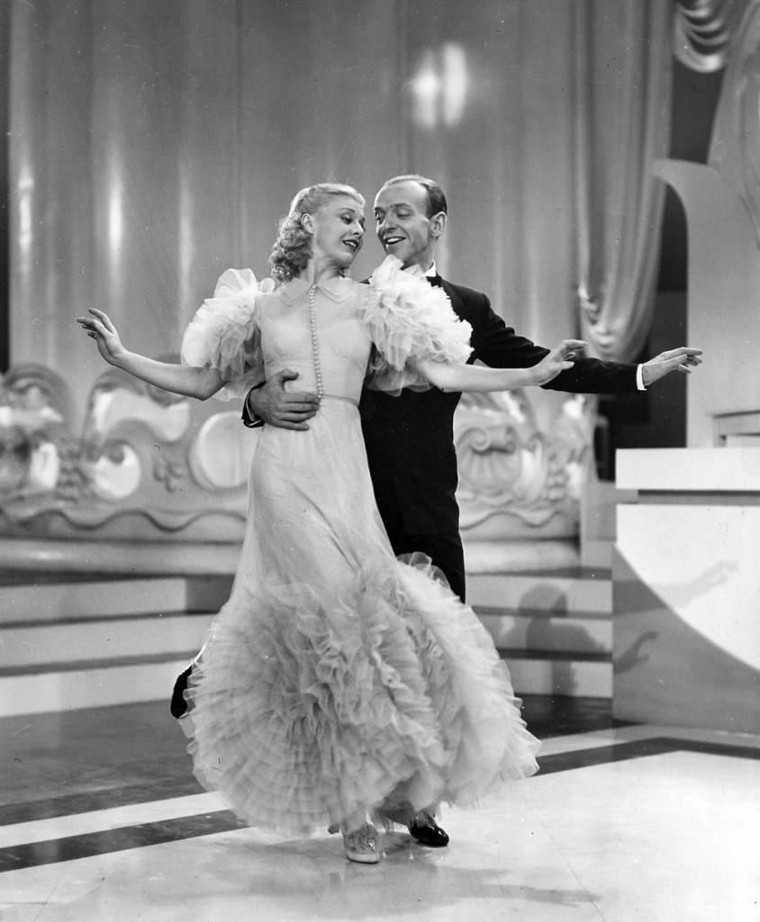 Dance instructor Penny Carroll (Ginger Rogers) dances with gambler John
