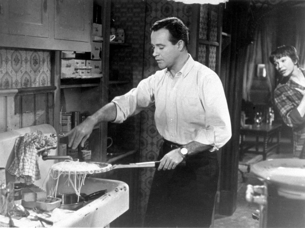 Jack Lemmon displays his pasta preparation technique to Shirley MacLaine.