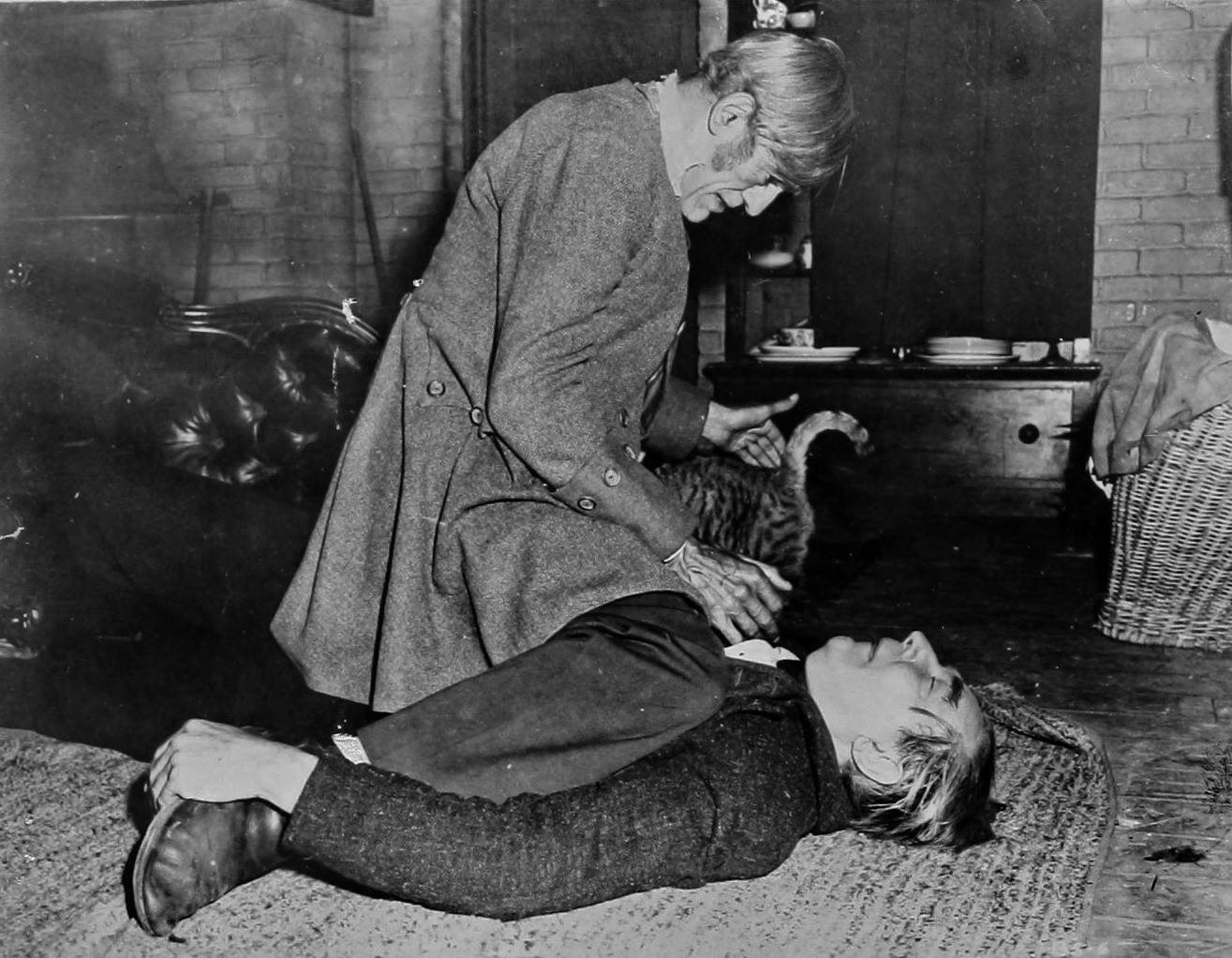 Boris Karloff preparing to harvest the body of Bela Lugosi