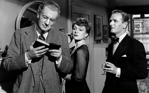 Andrew Crocker-Harris (Michael Redgrave) savors Taplow's Greek enscription, to which his wife (Jean Kent) reacts with some indifference, while colleague Frank Hunter (Nigel Patrick) seems more sympathetic.