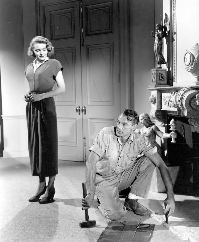 Dominique Francon (Patricia Neal) contrives to have architect Howard Roark (Gary Cooper) repair her fireplace.