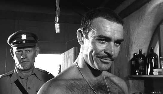 Regimental Sergeant Major Wilson (Harry Andrews) has no sympathy for imprisoned former Squadron Sergeant Major Joe Roberts (Sean Connery).
