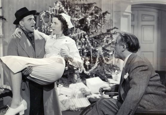 Jimmy Durante gives Mary Wickes a lift as Monty Woolley looks on.