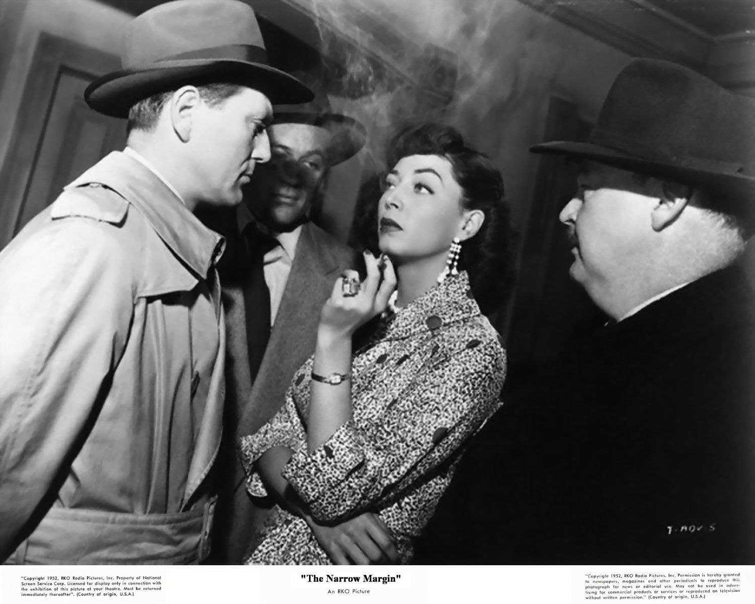 Tough guy Charles McGraw confronts the unflappable Marie Windsor.