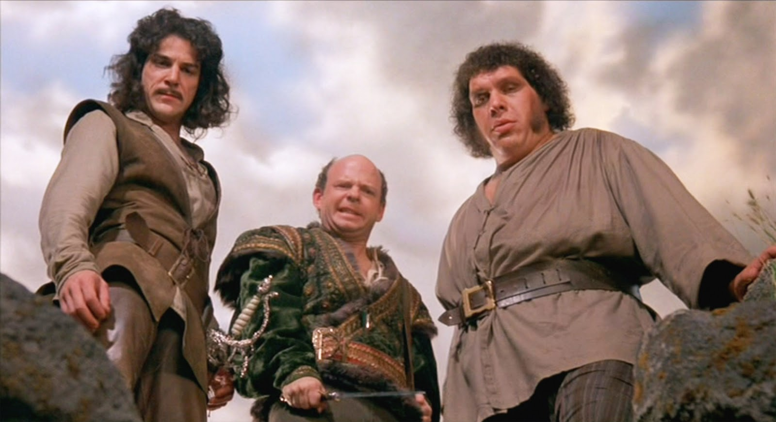 Mandy Patinkin, Wallace Shawn, and André the Giant gazing down at a foe.