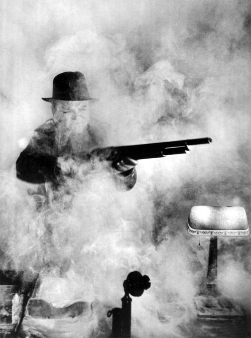 James Cagney is not deterred by a cloud of smoke.