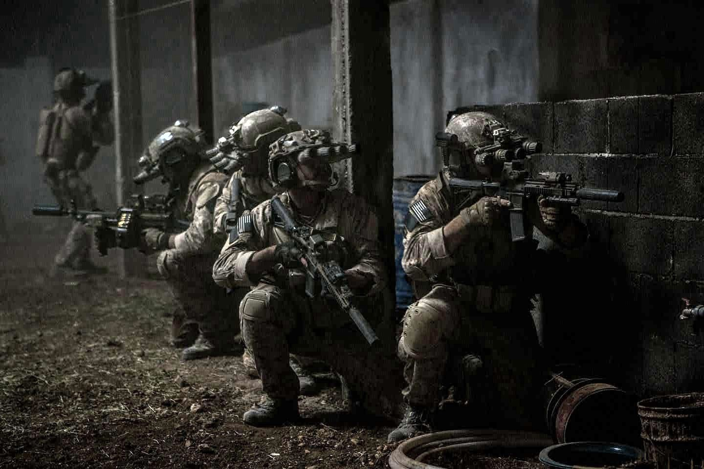 Operatives of US Navy SEAL Team Six (aka DEVGRU) close in on bin Laden's compound in the dead of night.